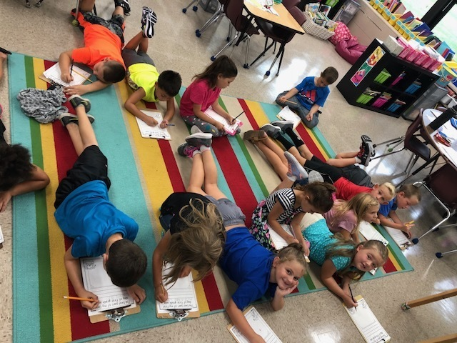 First graders working on writing skills