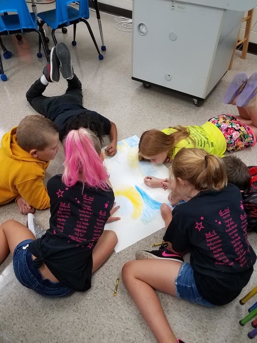 Third Graders showing Tribe Pride by working on Homecoming Posters
