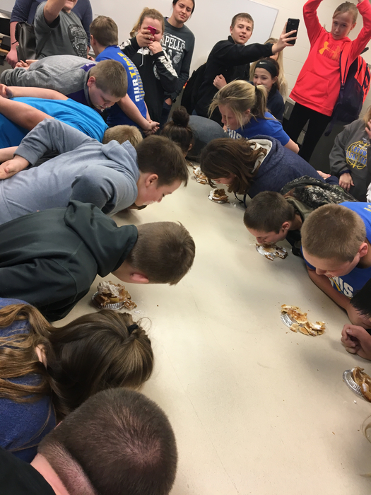 Middle schoolers compete in the mini pie eating contest