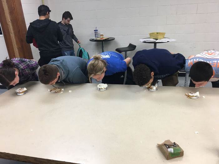 High schoolers compete in the mini pie eating contest