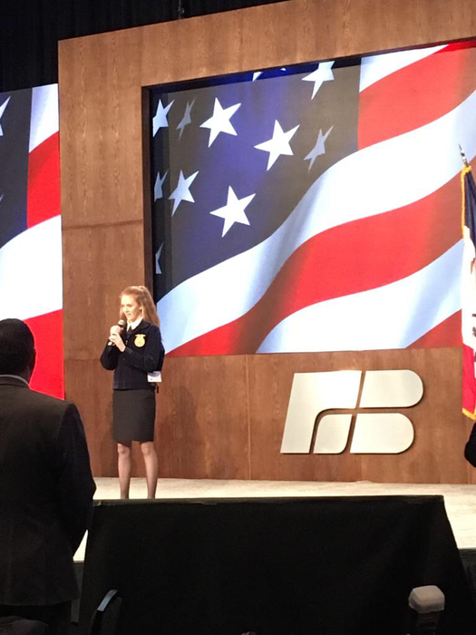 Claire Hoeg singing the National Anthem in Des Moines for the Annual Iowa Farm Bureau Meeting & Centennial Celebration