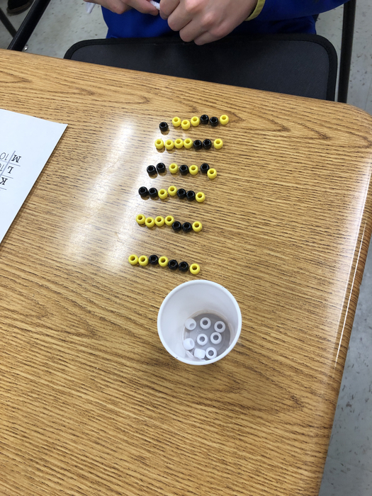 This is a student's name in code! Yellow is 1 and black is zero. Each letter is 7 beads long.