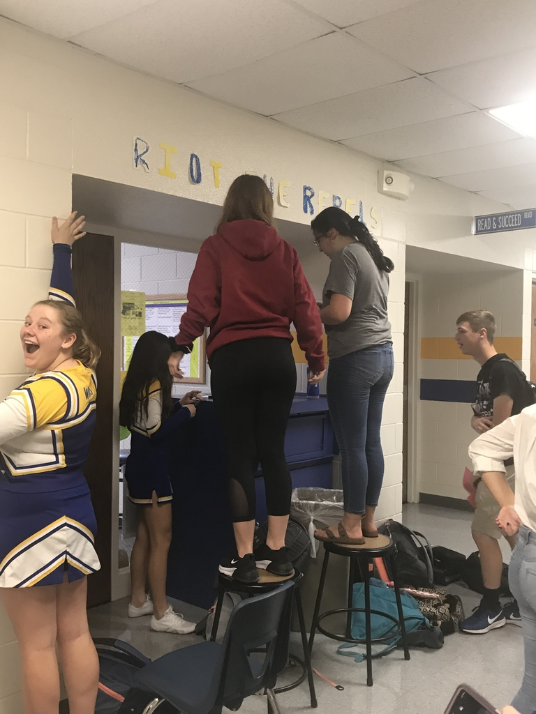 Freshmen working on their hallway.
