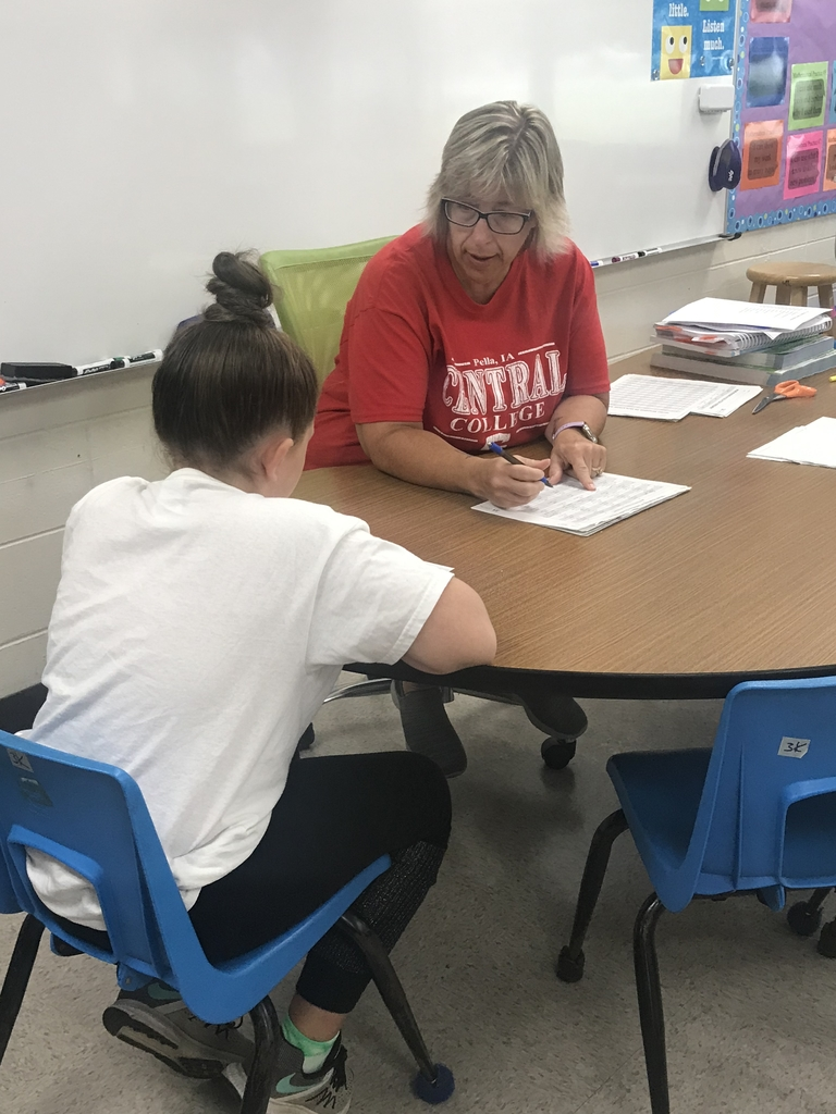 Mrs Kinsey working with a student.