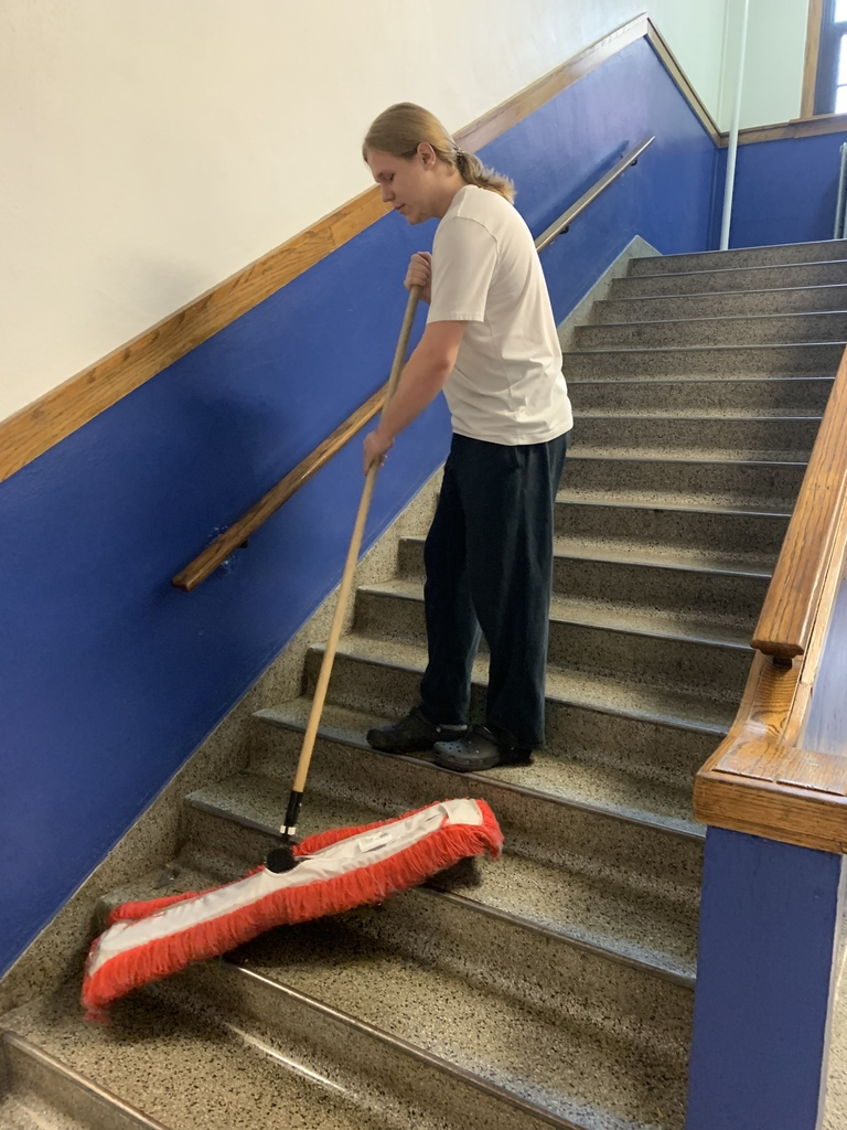 Sweeping the stairs.