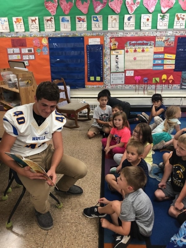 Football boys reading at the elementary.