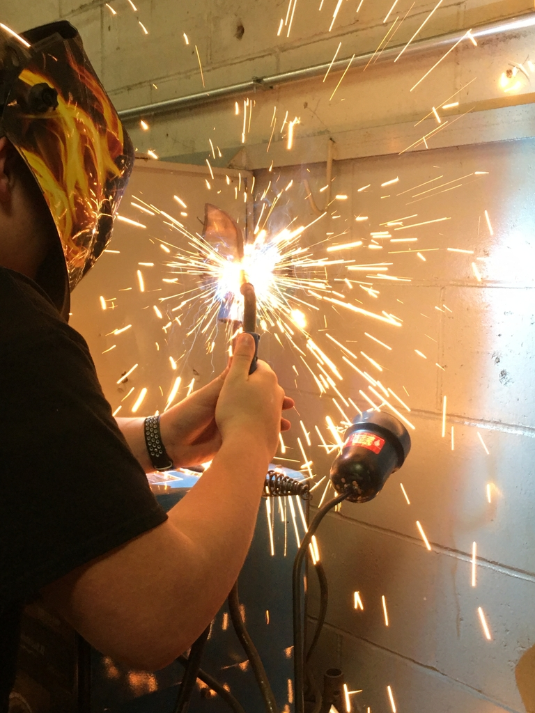 Dustin welds on flowers